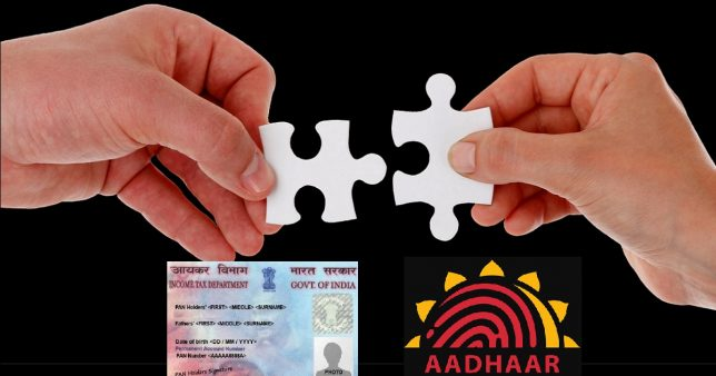 Image of two hands trying to join puzzle pieces which is symbolic of trying to link Pan with Aadhaar