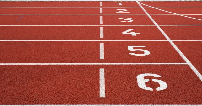 Image of a starting line of a race track with six lanes indicative of the 6 Midcap Mutual Funds beat Nifty Midcap 150 in the last 5 years