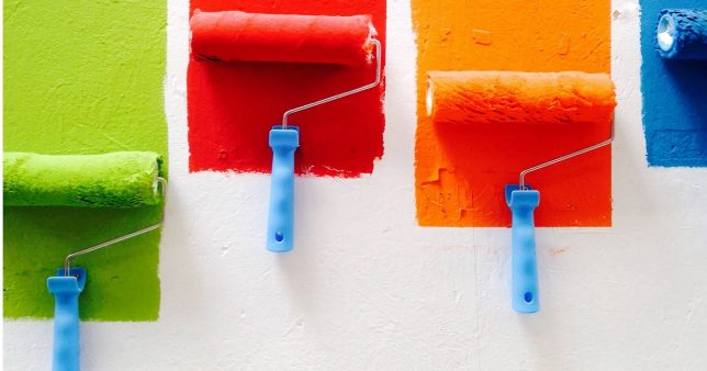 paint rollers with different colors on a wall representative of the change in investment strategy of ICICI Multi-asset fund