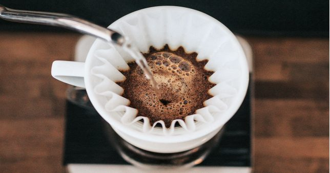image of coffee being filtered representative of Momentum, Low Volatility Stock Screener (Feb 2020)