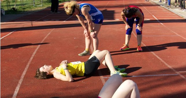 image of tired athletes on the track representative of Only 3 midcap mutual funds have beat Nifty Next 50 consistently