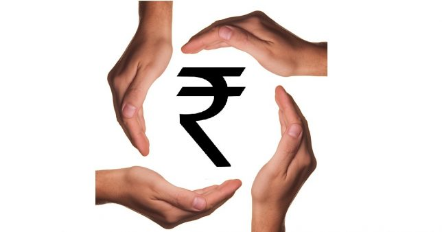 image if hands protecting the rupee symbol representative of Why deposit insurance of five lakhs is not enough to protect investors