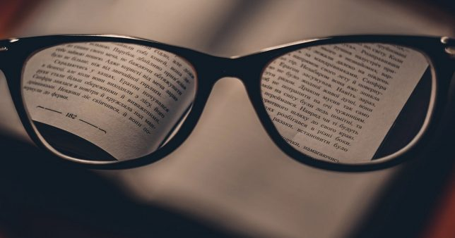 image of a spectacles with the focus on fine print symbolic of spotting multi-beggar stocks with earnings power box