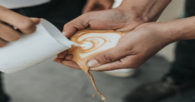image of a coffee prepared in the cup of a hand representative of investing without a plan