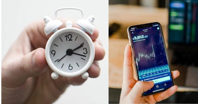 image of one hand holding an alarm clock and another hand watching a stock price on a mobile screen representing timing the market