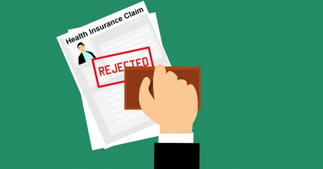 image of health insurance claim being rejected signifying the consequences of failing to include important info while buying insurance and what to do
