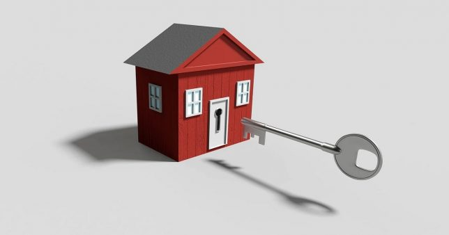 image of a key about to enter a house representing the way to use Tax benefits on HRA and home loans