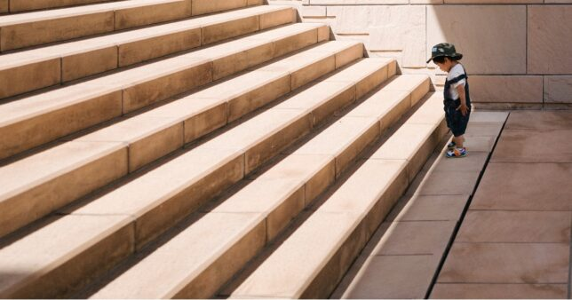 Image of a child staring at a daunting step of steps he needs to climb just as a beginner would feel like when they are about to start investing in mutual funds