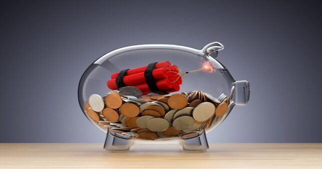 image of a piggy bank with a lit dynamic stick representing the risks of investing in Tamil Nadu Power Finance Fixed Deposits