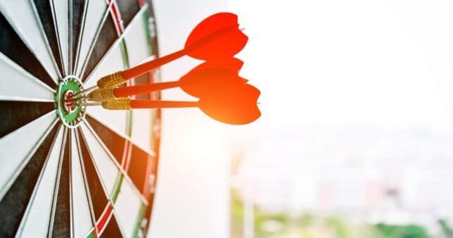 Three darts on target representing SIP performance of AXIS Smallcap mutual fund
