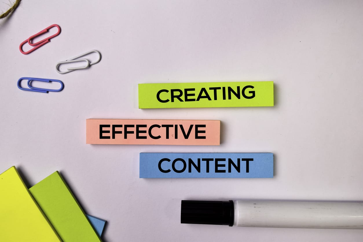 Creating Effective Content on sticky notes isolated on white background.