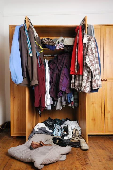 Untidy wardrobe to represent a disorganized investment portfolio